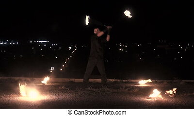 Fireshow on city background - Street performances of fire...