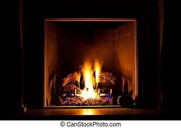 fireside - gas fireplace pretending to burn concrete logs