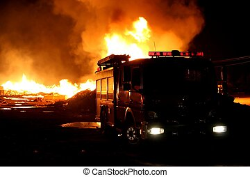 Firetruck and Fire - A firetruck in front of a blazing fire...