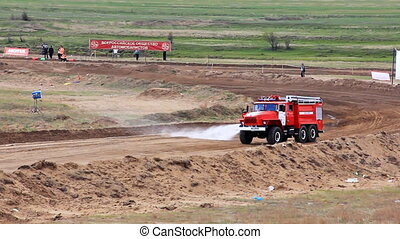 Firetruck on rally cross track in russian province wets the...