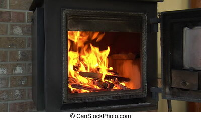 firewood added to woodstove