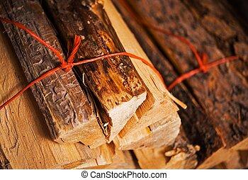Firewood Bundles - Bundles of Pine Firewood Closeup Photo....