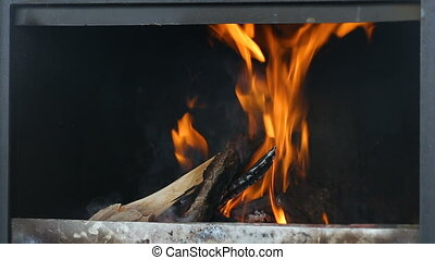 Firewood burn in the stove. Rural background with fire flames.