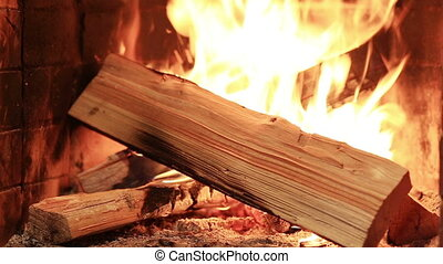 Firewood burning in fireplace interior fire red ashes
