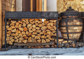 Firewood for the winter. Firewood for barbecue. A background made of wood. Cut and chopped logs with ready-made pieces of wood for heating. Ecological concept.