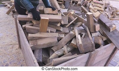 Firewood in wooden container