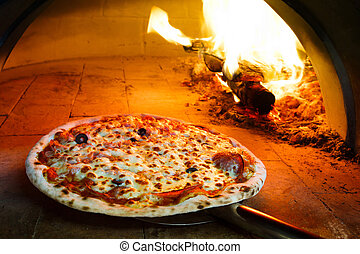 Firewood oven pizza - Close up pizza in firewood oven with...