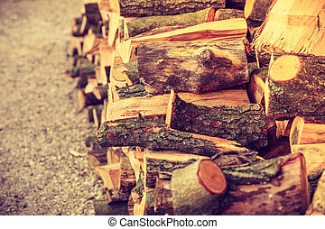 Firewood, pile of wood standing outside