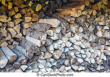 firewood stacked in a woodpile outdoor closeup