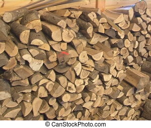 Firewood stacked woodshed - Firewood stacked in woodshed and...