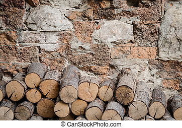 Firewood with old block background