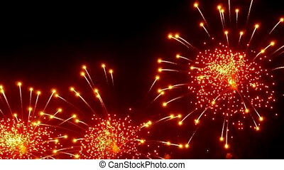 Firework display at night on black background. Bright red...