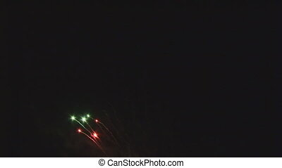 firework from red and green stars at night