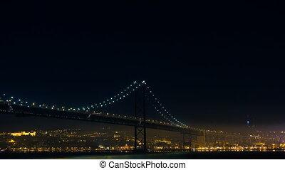 Firework near the 25 de Abril Bridge in Lisbon Portugal,...