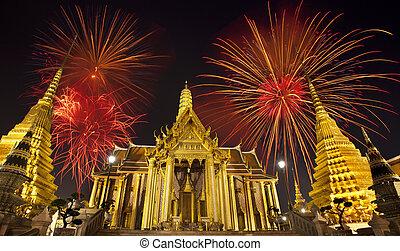 Firework on Wat Phra Kaeo (Thai royal palace) between King...