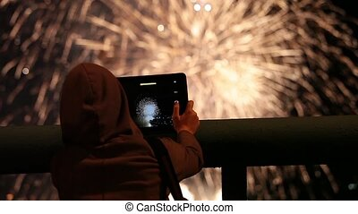 Firework pyrotechnic show - Girl using tablet to record...