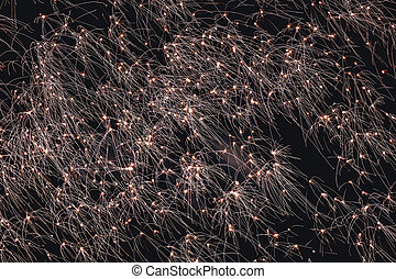 Firework sparkles exploding in bright light