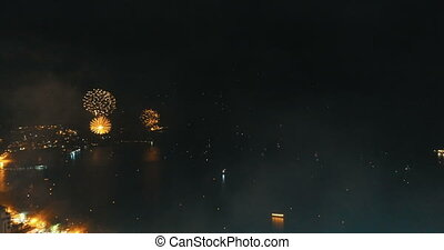 Fireworks above the city on New Year's Eve - Aerial drone...