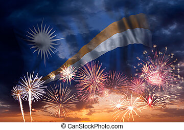 Holiday sky with fireworks and flag of Marshall Islands, independence day