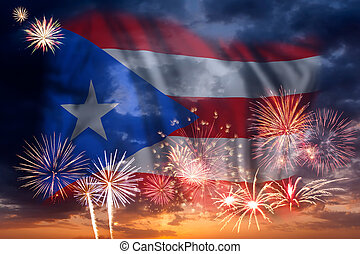 Fireworks and flag of Puerto Rico - Holiday sky with...