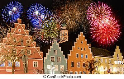 Fireworks at the illuminated town of Schrobenhausen during christmas time.
