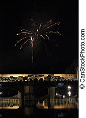 ?Fireworks by the historic bridge in Florence