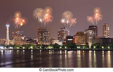 Fireworks celebrating over Yokohama cityscape at night,...