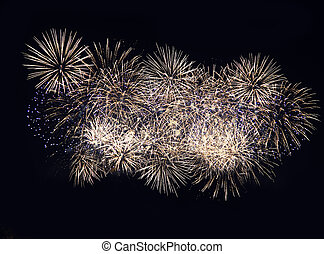 Fireworks display on dark sky background. Flashes of red and white fireworks against the night black sky. Brightly colorful fireworks