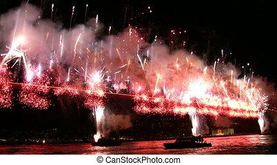 Fireworks exploading over the bridg