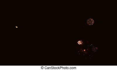 Fireworks explosion and moon in super slow motion