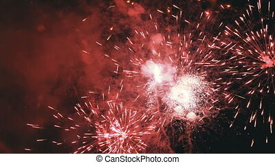 Fireworks Flashing in the Night Sky. Slow Motion. Real Fireworks with Smoke
