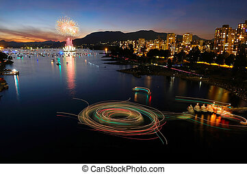 Fireworks in Vancouver and ferry boats treks on the water at night.