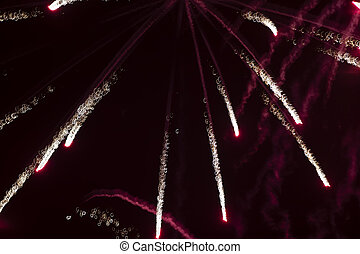 Fireworks light rays of red on a black background.