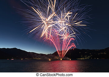 Fireworks on the lake in a summer night