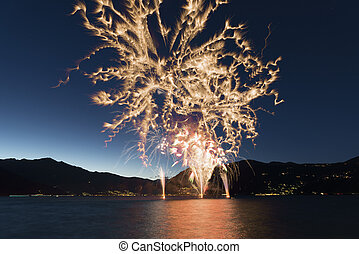 Fireworks on the Lake Maggiore in a summer night