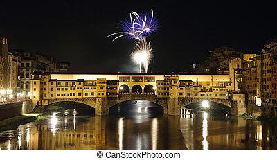 Fireworks over Arno river and Ponte Vecchio on San Giovanni...