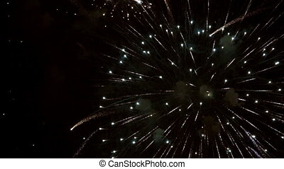 Fireworks over black sky in super slow motion