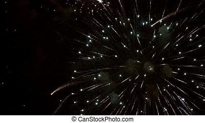 Fireworks over black sky in super slow motion