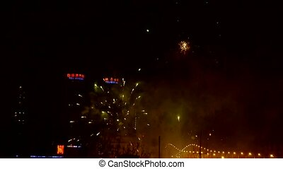 Fireworks over city building at...