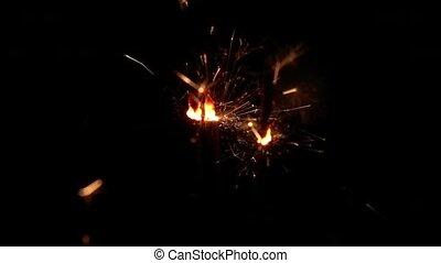 Fireworks sparkler on black background. Slow motion -...