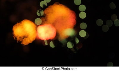 Fireworks with bokeh. Green circle and red.