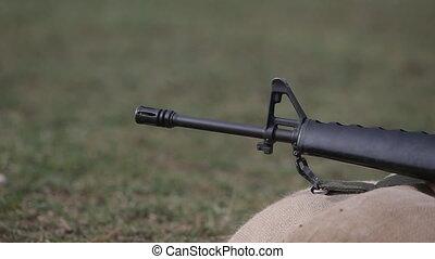 firing M16 rifle