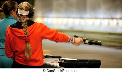 Firing the Air Pistol - Professional shooter firing from the...