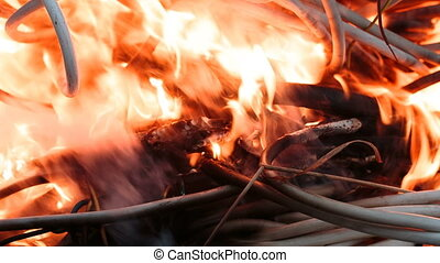 Firing wire in fire - wires on fire. Firing winding...