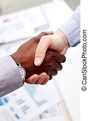 Firm handshake - Vertical shot of a firm business handshake...