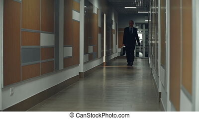 Firm Tread - Slow motion of business man approaching camera...