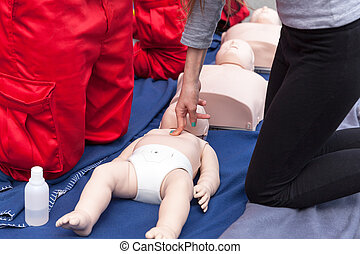First aid - Infant CPR training manikin first aid....