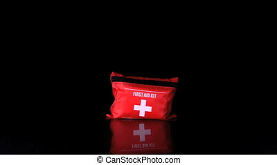 First aid kit falling and bouncing in slow motion