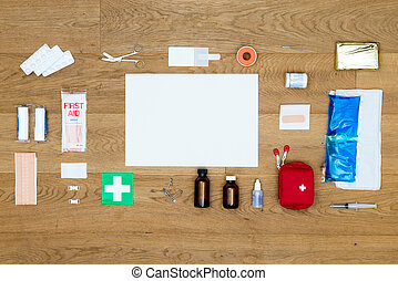 First Aid kit items aligned on wooden surface with copy space area