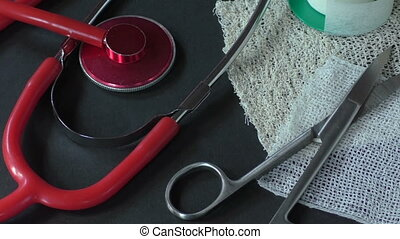 First aid kit with dressing material and red medical stethoscope